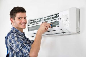 ac technician repairing air conditioner